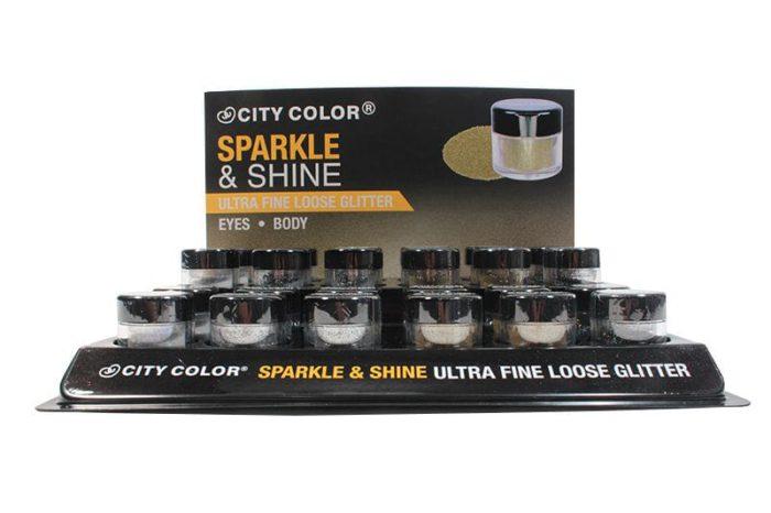 Un display negro que contiene 24 unidades de City Color Sparkle and Shine Loose Glitter