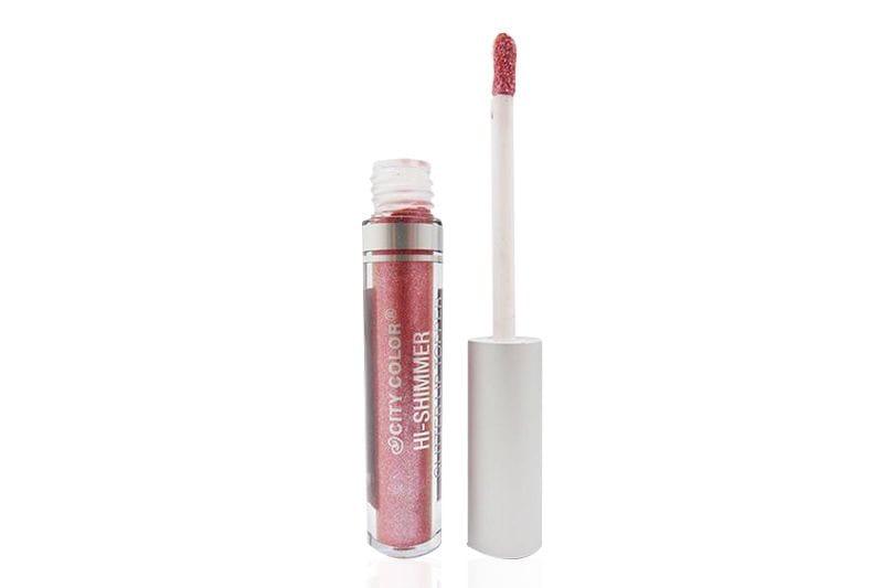 Un ejemplo de un Iridiscente Pink City Color Hi-Shimmer Glitter Lip Topper con el aplicador a la derecha
