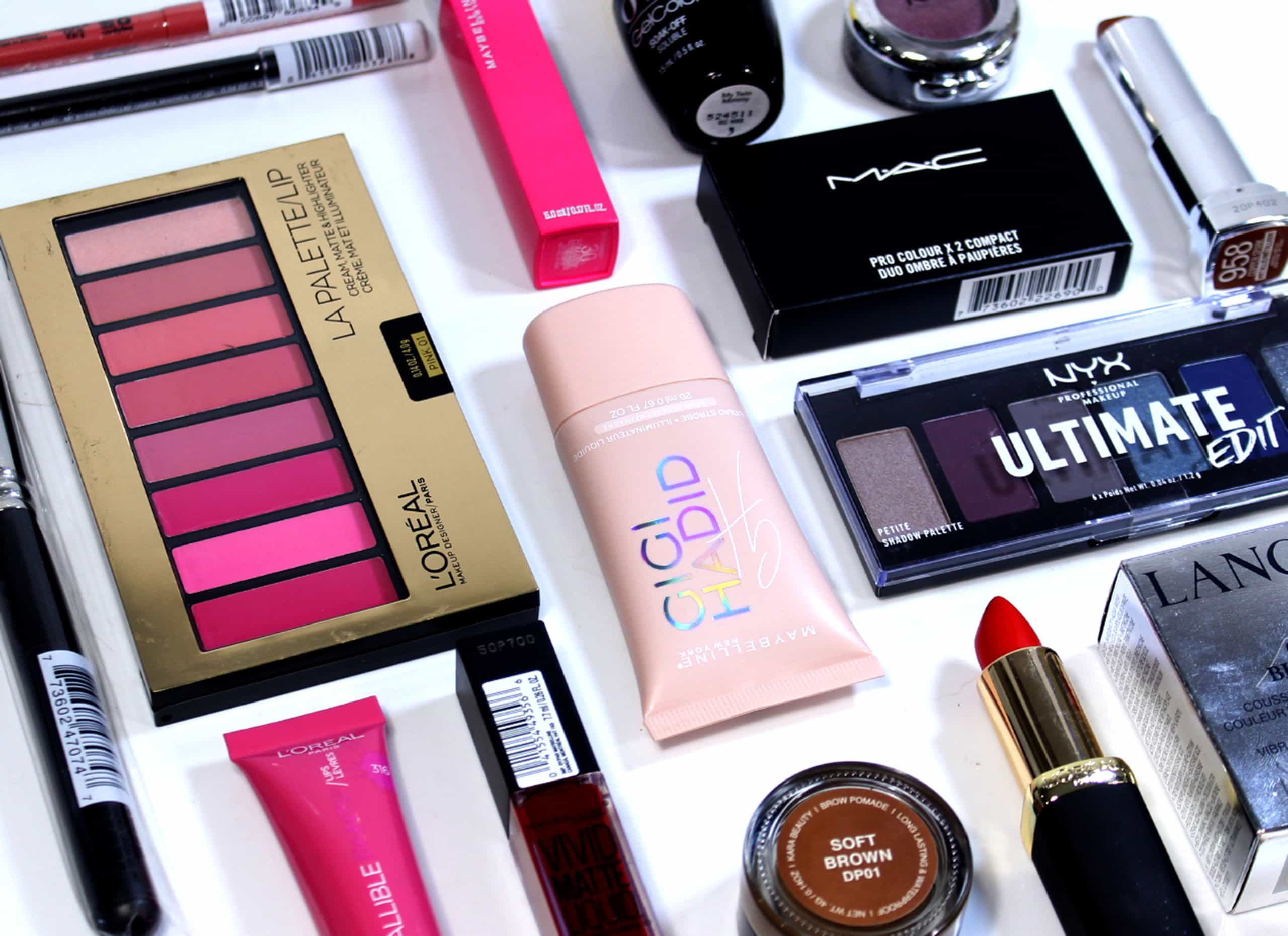 A collection of different cosmetics products from American makeup brands on a white background